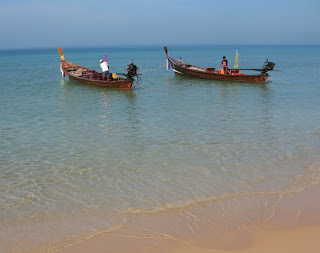 Longtail boats off Karon Beach