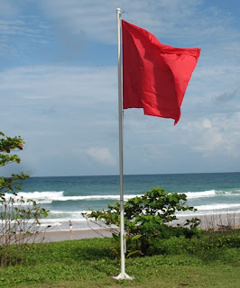 Red flag and sunshine, Karon Beach, 19th August