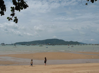 My kids explore the beach near Kan Eang Seafood