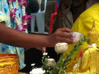 Cleaning Buddha image at Songkran