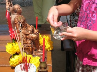 Cleaning King Rama V image at our house on Songkran day April 13th