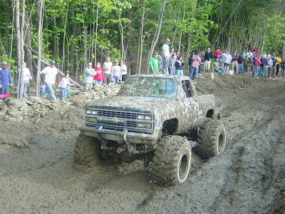 This Chevy has 2 1/2 ton axles and a custom lift. A modified 454