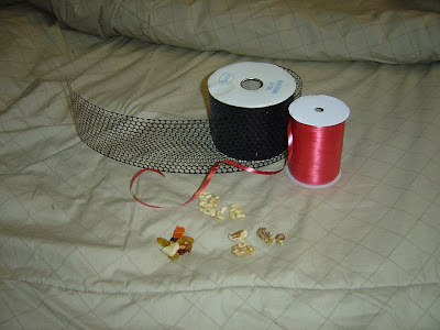 homemade foraging toy items: honeycomb ribbon and red gift ribbon