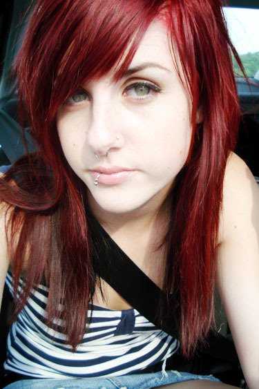 black hair with red and blonde streaks. red and londe highlights in