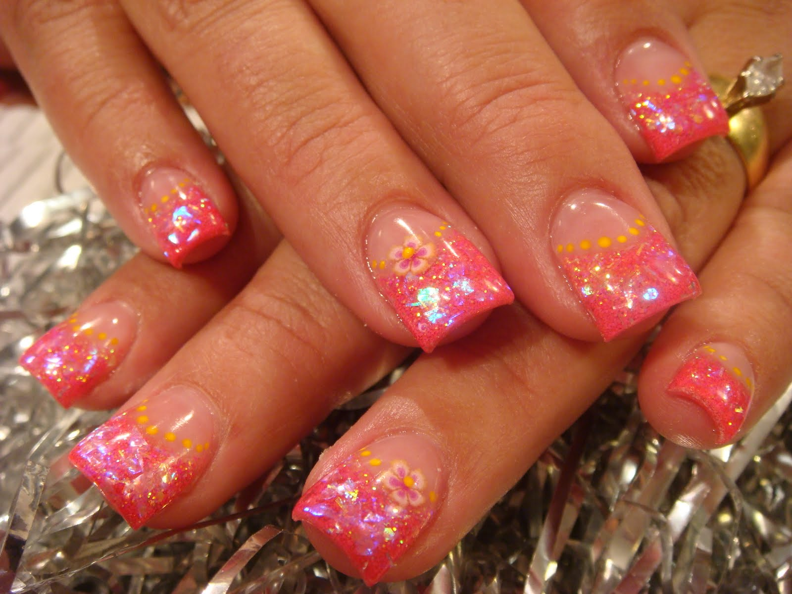 This is impression nail art with spring colors.
