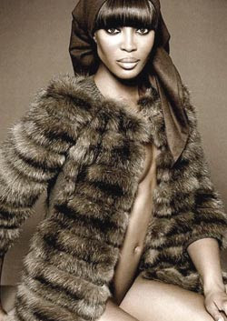Naomi Campbell poses naked in fur