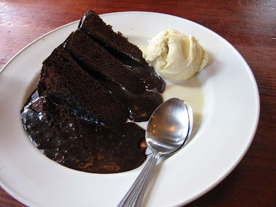 slice of hot chocolate fudge cake with a scoop of vanilla ice-cream.