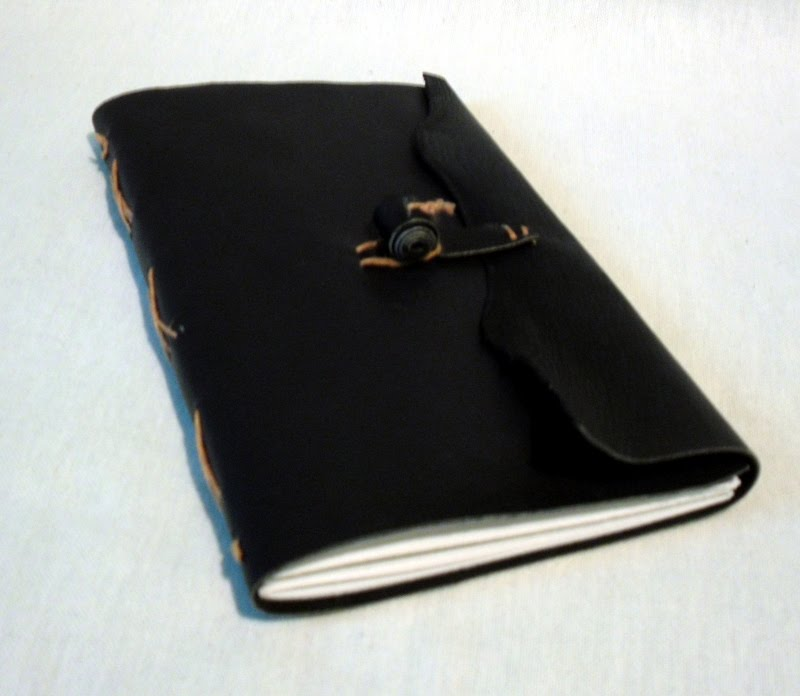 book in hand limp leather binding black