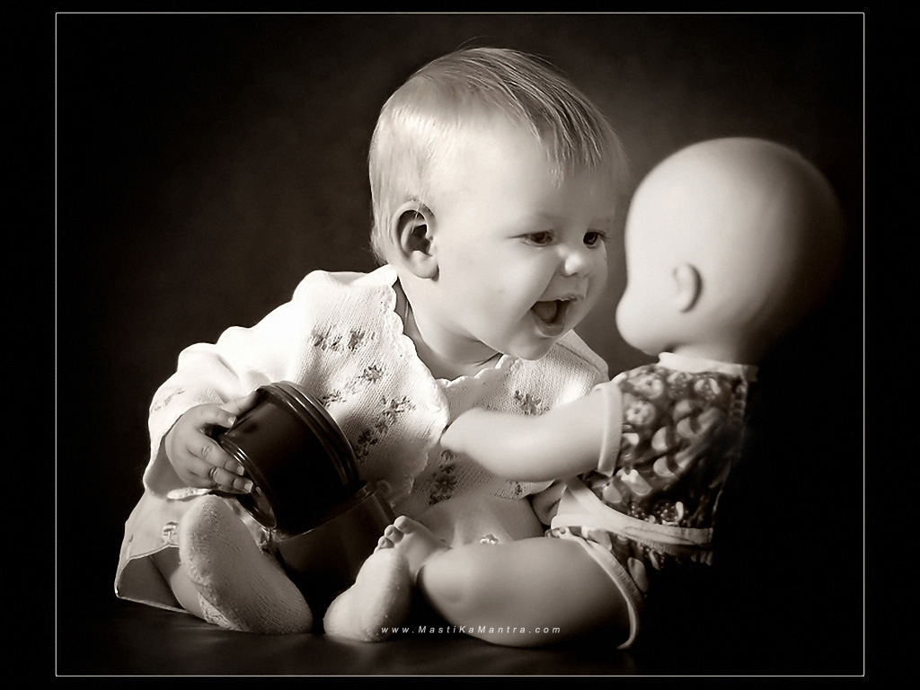 Cute baby boy playing with doll wallpapers