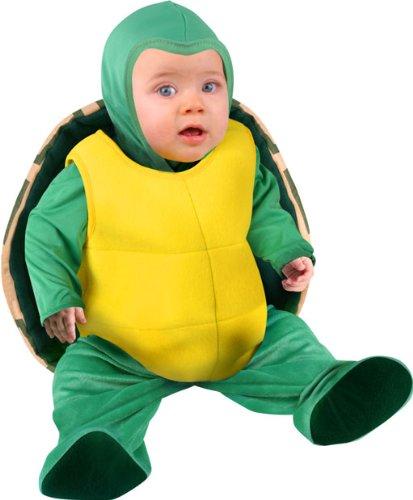 Cute baby boy in tortoise costume