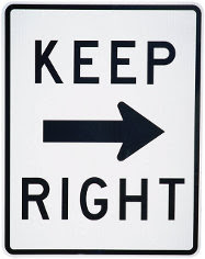 What is the shape of a Keep Right sign and how should the driver react when he sees one