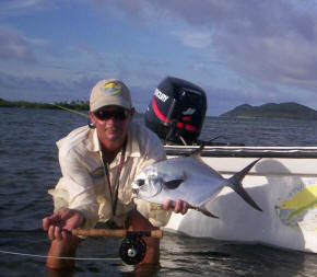Photo of Mango Creek Lodge guide Perry holding a small permit