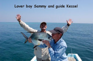 Photo of Sammy kissing a permit while Mango Creek Lodge guide Kessel cheers in the background