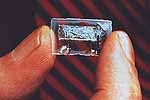 It was a relatively simple device that Jack Kilby showed to a handful of co-workers gathered in TI's semiconductor lab 50 years ago -- only a transistor and other components on a slice of germanium. Little did this group of onlookers know, but Kilby's invention, 7/16-by-1/16-inches in size and called an integrated circuit, was about to revolutionize the electronics industry.