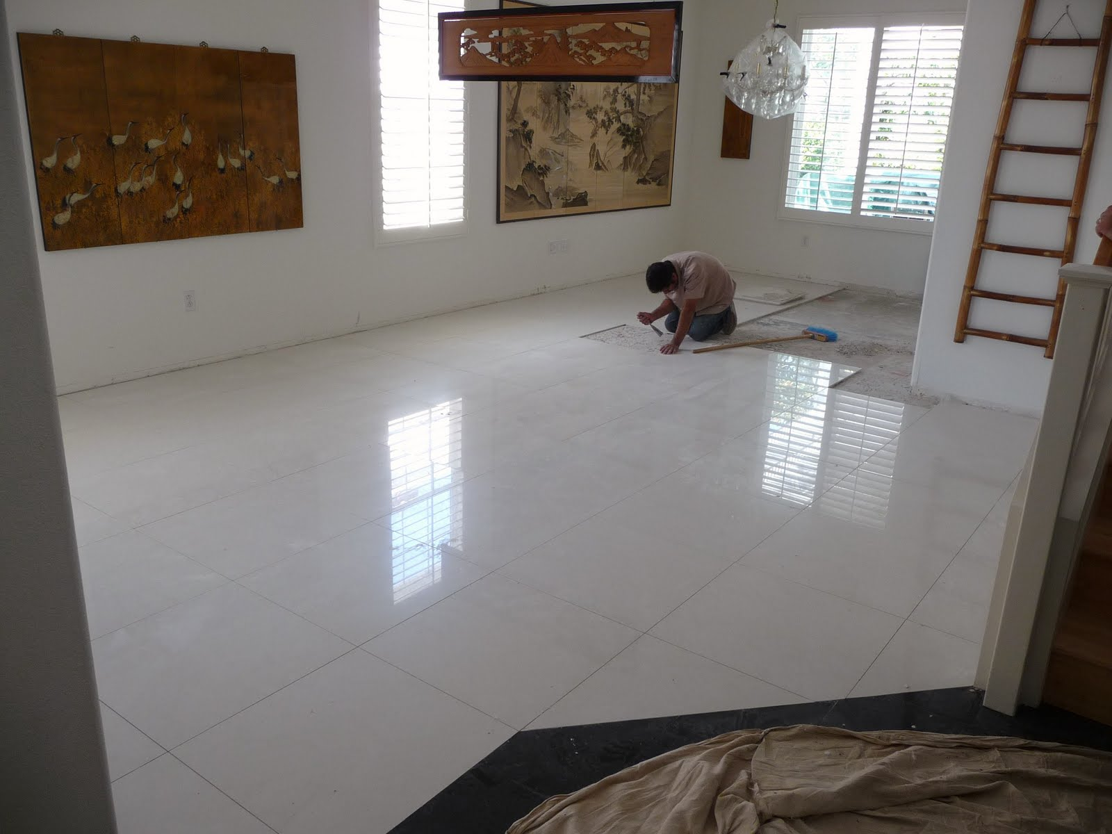 Installing white granite 2ft x 2ft tiles - living and dinning rooms