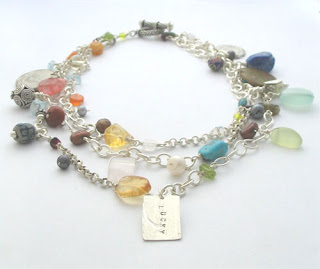semiprecious stones, glass beads, coins and sterling silver