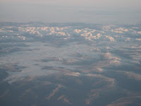 50,000 Feet Somewhere Above Mongolia - The cloud in the valleys gives you some perspective
