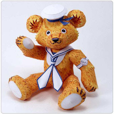Cute teddy bear by paper