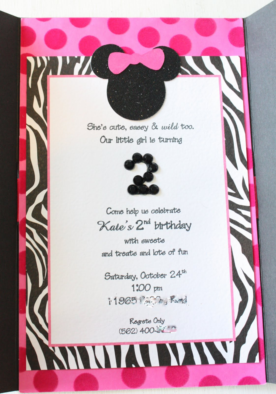 We added a glitter Minnie applique at the top of the invite I also