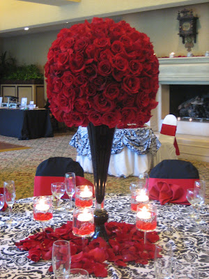 Black white and red wedding flowers heavenly blooms red is such a dramatic color even more so when used as a solid color against black and white the contrast of the red roses against the damask tablecloth mightylinksfo Images