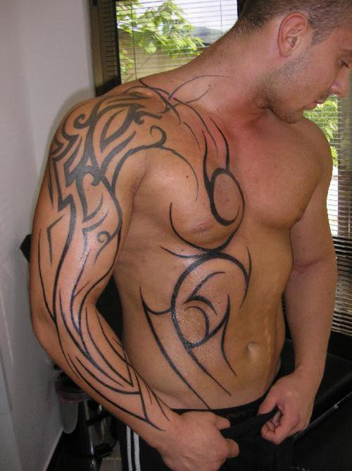 muscle tattoos. tribal tattoos for chest and
