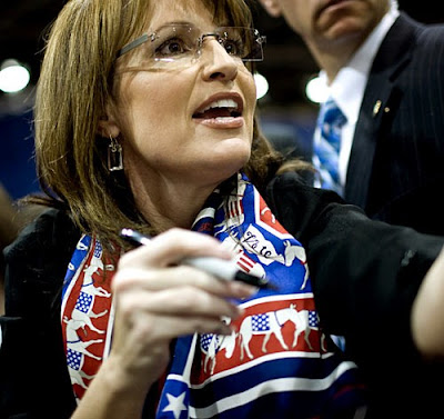 Sarah Palin wearing a Democratic scarf