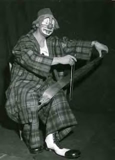 Paolo the Clown playing a musical saw in 1954