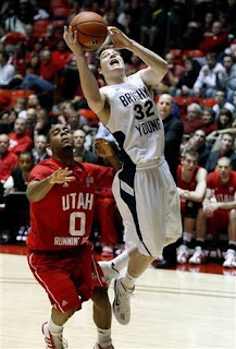BYU's Jimmer Fredette drives in the lane against a University of Utah player