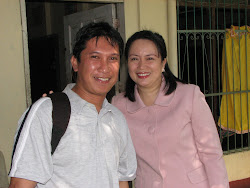 Councilor Mabel Acosta and multi-awarded photo journalist Bing Gonzalez
