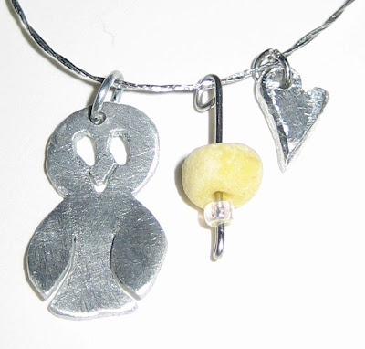 handmade easter chick pendant with beads and heart charms handmade jewellery by surf jewels