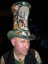 MUSEUM OF BRITSH FOLKLORE: SIMON COSTIN IN LAUNCH PARTY HAT BY STEPHEN JONES