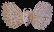Behornad ängel