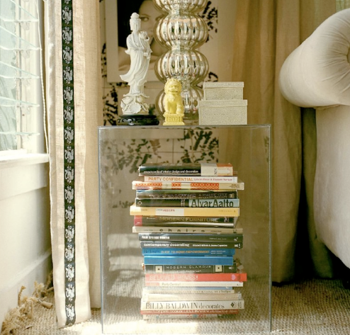 glass or lucite side table with no shelf or base, via Things We Heart