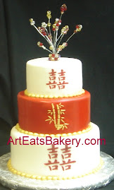 Three tier red and white fondant wedding cake