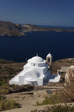 Milos hillside church, overlooking harbour near Adamas