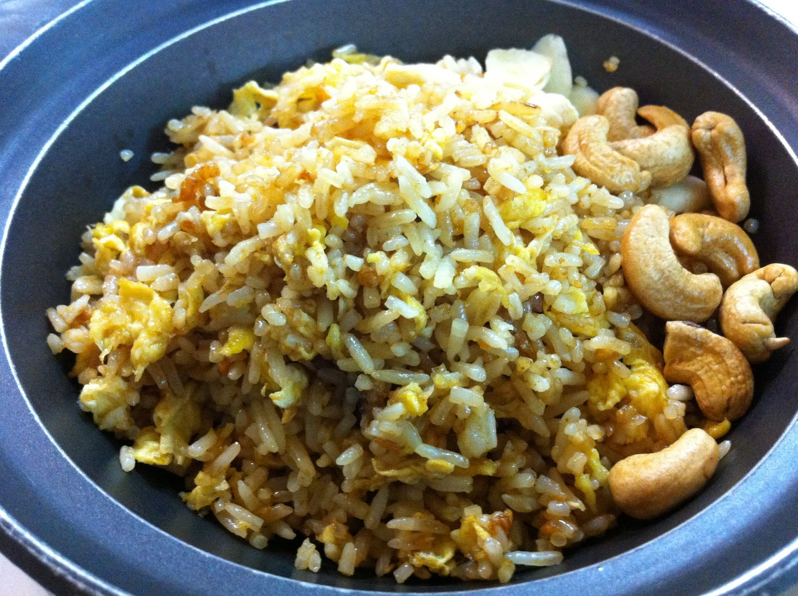 The pescetarian eats salted fish fried rice in claypot for Fish fried rice