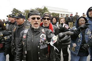Demonstrators who support the war, heckle anti-war marchers as they walk from the National Mall to the Pentagon.(Gerald Herbert / Associated Press) Mar 17, 2007
