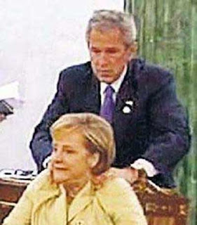 Bush giving surprise massage to German Chancellor Angela Merkel