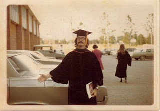 "Me impersonating an Economics professor, May 1973. One of my teachers hired me, sort of, to ""be"" him at the graduation ceremony. The guy was about five foot two, and the gown came up to my knees. It was pretty obvious I was not a professor, and the school officials on the stage were steaming mad. It was great fun."