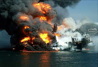 "The Deepwater Horizon, BP's oil platform in the Gulf of ""Mexico,"" burning on April 20, 2010"