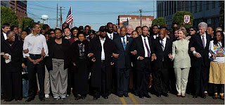 Barack Obama and Hillary Clinton marching in Selma, Alabama, March 4, 2007