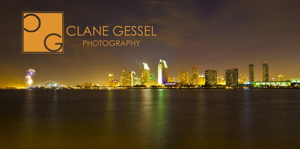 The downtown San Diego Skyline at night with fireworks.  reflection as seen from the Coronado.