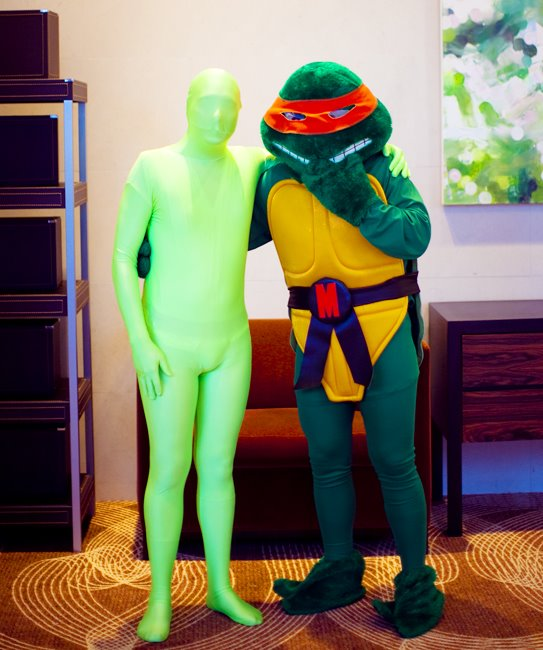 Michaelangelo and the green lantern body suit guy