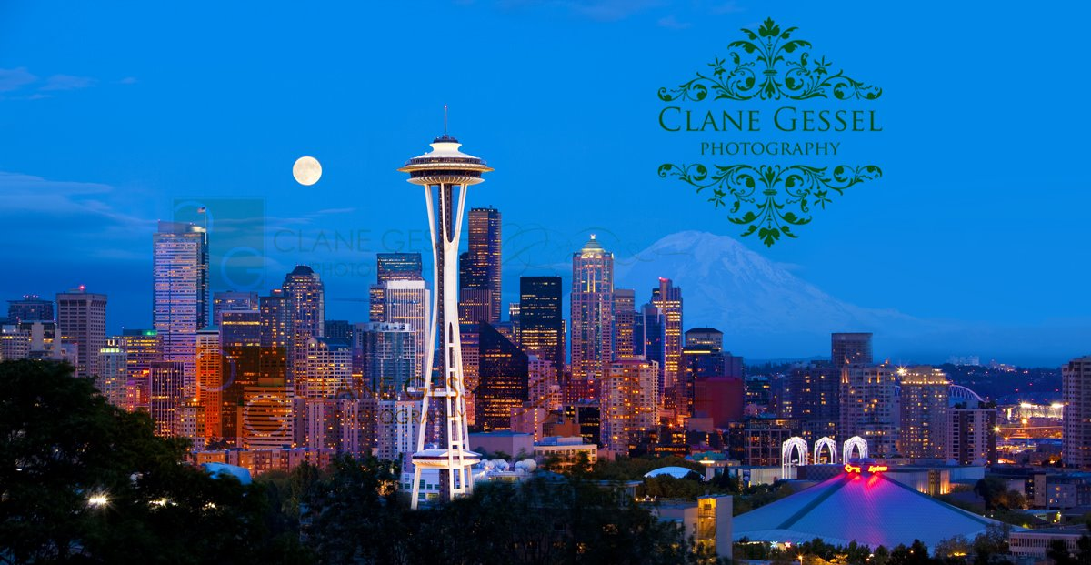 The space needle and downtown seattle cityscape from Kerry Park with mount rainier and full moon
