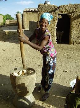 Mama pounding corn