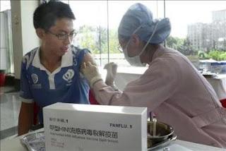 14 de los 40.000 vacunados en China contra la gripe A muestran reacciones adversas. EFE