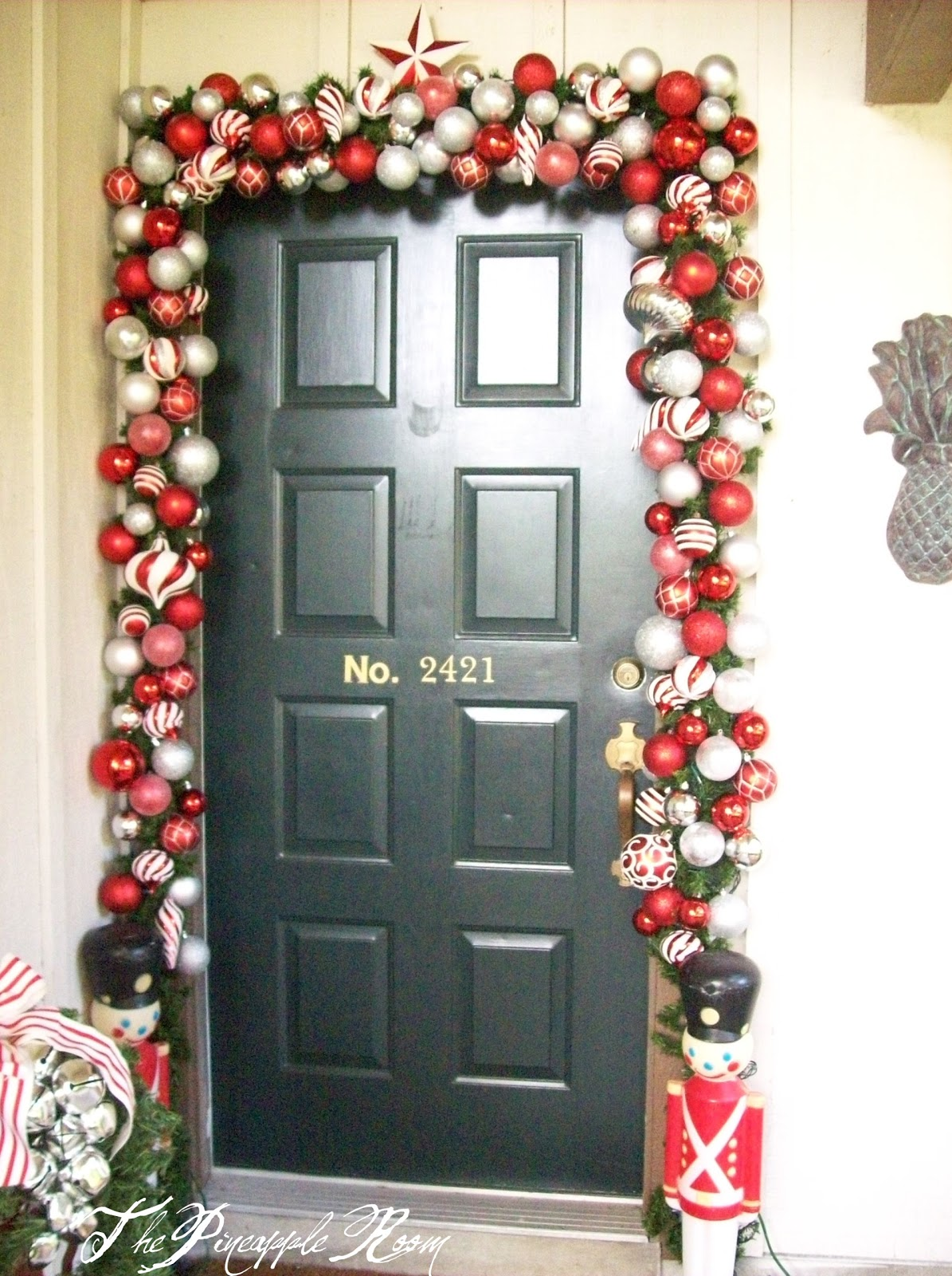The pineapple room a very merry front door for Door garland christmas