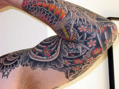 Japanese Sleeve Tattoo Design. Koi fish are an ever well-liked theme for