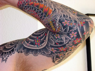 Koi fish are an ever well-liked theme for Japanese Sleeve Tattoo styles.