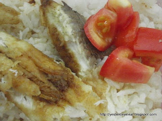 fried fish and tomatoes meal